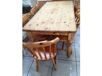 LARGE RUSTIC PINE FARMHOUSE TABLE AND 8 CHAIRS , TABLE NEEDS SANDING AND WAXING ON THE TOP (OR WE CO