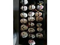 21 small porcelion glass masks