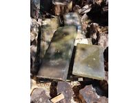 Reclaimed Yorkshire stone copings bought for a wall that never got built. Excellent condition.