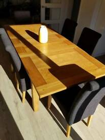Oak dining table with 6 chairs and matching side board