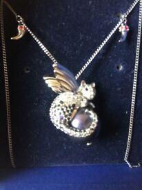 Stunning Swarovski passenger angel cat pendant (1110359)