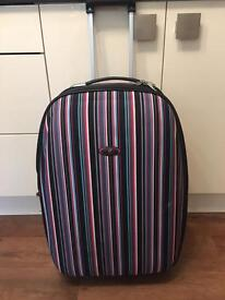 Pull along suitcase with expansion panel