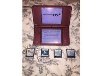 Nintendo DSi XL with case, charger and 4 games