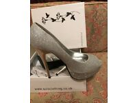 Quiz heels , silver colour , size 7 . Worn only 2 times