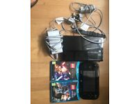 NINTENDO WII U (black) with two games:(Lego starwars the force awakens,Lego Jurassic Park) unboxed