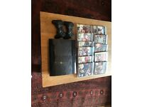 PS3 slim console, 2 wireless controllers, games, power cable