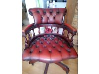 Leather burgundy Captains swivel chair. Adjustable height and tilt.