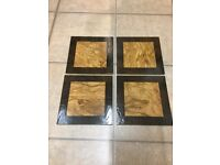 A set of 4 square placemats for sale.