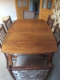 Solid wood extending dining table and 6 chairs.