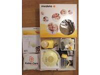 Medela Swing electric Breast pump with Calma teat- as new