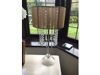 Table lamp with beige shade and glass droplets