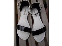 Brand new Odeon sandals size 4