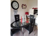 glass table and four chairs -immaculate condition