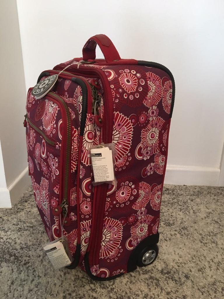 6325353c3 Kipling expandable cabin bag / case (firework design in lipstick red ...