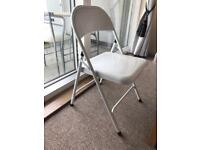 X2 white metal folding chairs