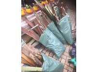 Bags of old fence wood