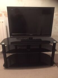 "Black sharp 32"" tv and black glass stand"