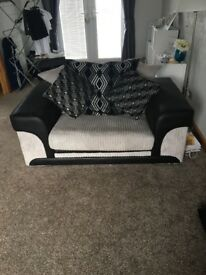 Black and grey 3 seater and cuddle chair SOLD