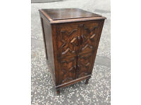 Oak cupboard , with carved panelled doors and on barley twist feet. Size L 19in D 19.5in H 35in.