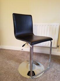 Black adjustable bar stool