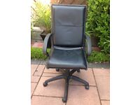 Black office/study swivel armchair with adjustable height lever.