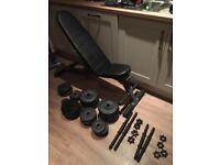 Complete dumbbell set up with bench. As new!