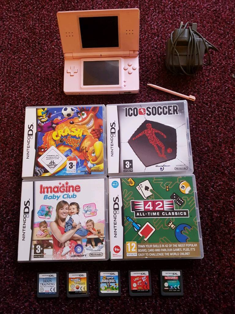 Pink Nintendo ds with 9 games