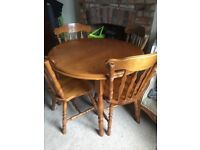 Hard wood extendable dining table 4/6 seats