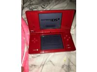 Used once NINTENDO DSi .in red with camera mic wifi & 16 games