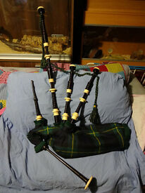 Gillanders & Mcleod stamped, African blackwood bagpipes.