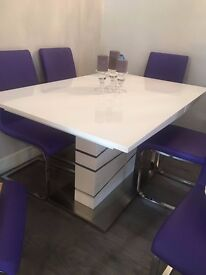 White lacquer extendable dining table with chrome base and 6 purple chairs- new condition