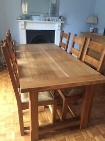 Oak dining table,6 chairs and 2 table extensions
