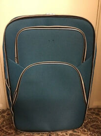 Very big green suitcase in very good condition only £25