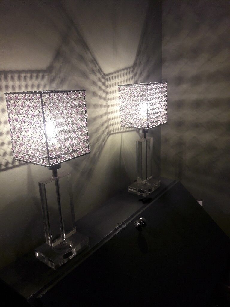 2 glass lamps with glass beaded shades.