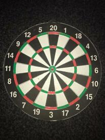 Double sided dart board and darts