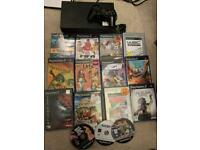 Black Sony ps2 console with games