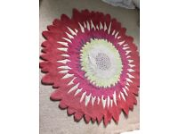 A big flower shape rug from Next