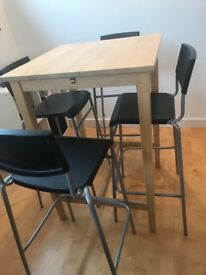 Bar table + 4 chairs