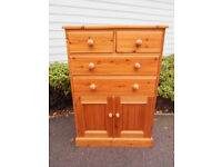 Solid pine chest of drawers of 2 over 2 with cupboard base *can deliver