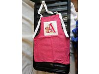 Childs fabric apron, Letter A