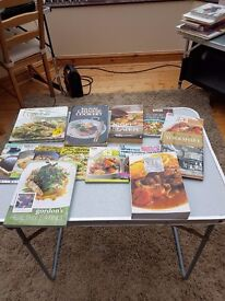 A selection of used cookery books including Gordon Ramsey, Ken Hom and Nigel Slater