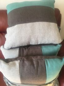 Teal and grey cushions