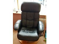 black leather recliner chair and footstool