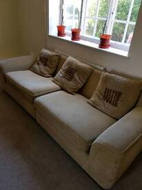 Large Beige sofa with cushions