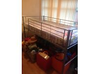 Single sized metal bed with mattress