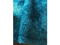 240cm x 150cm teal coloured rug. Hardly used, immaculate condition!