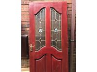 Door made from hardwood and 2 glass panel with decorative pattern
