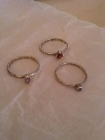Sterling silver ring set each with a single gemstone