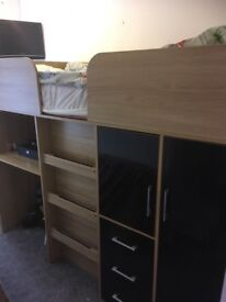 High bed with storage. Great for small rooms.