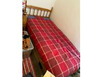 Single pine bed frame and mattress.